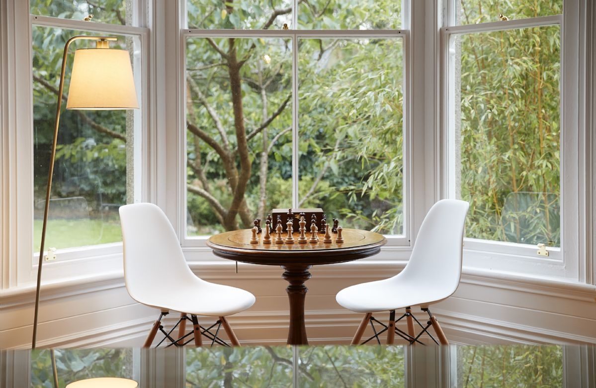Enjoy a game of chess looking out to the beautiful garden at Rosevean
