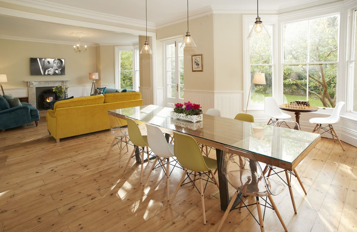 Ground floor: Open plan sitting and dining room seating twelve guests