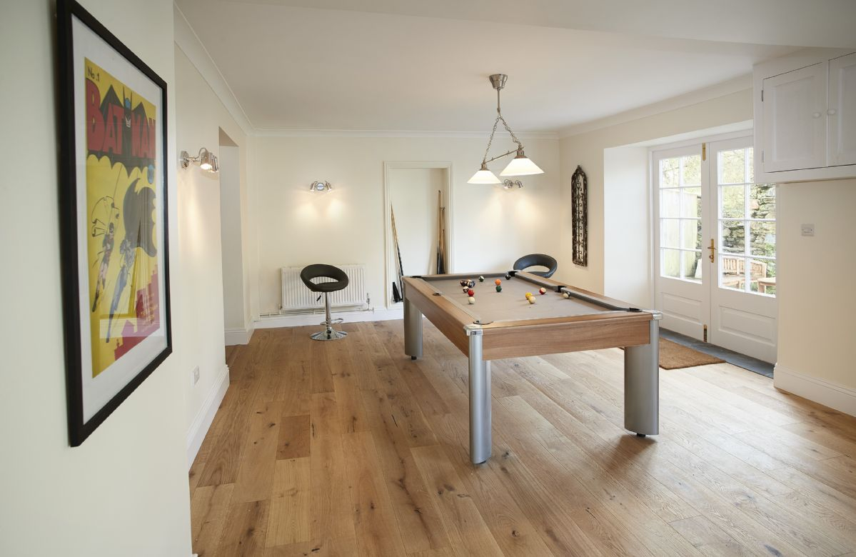 Lower ground floor: Large games room with a full size pool table