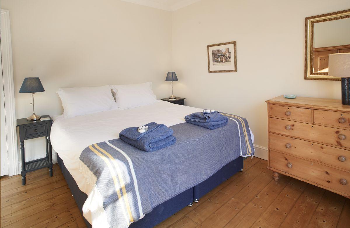 First floor: Bedroom with 6' super king size zip and link beds and en-suite shower room