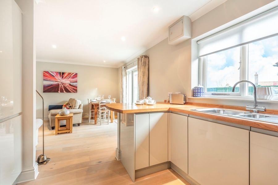 Flint Cottage, Beacon Hill | Kitchen thro to sitting area