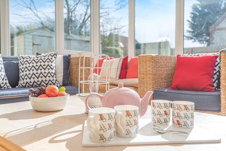 Eastwood House 2 Bedrooms | Tea in conservatory
