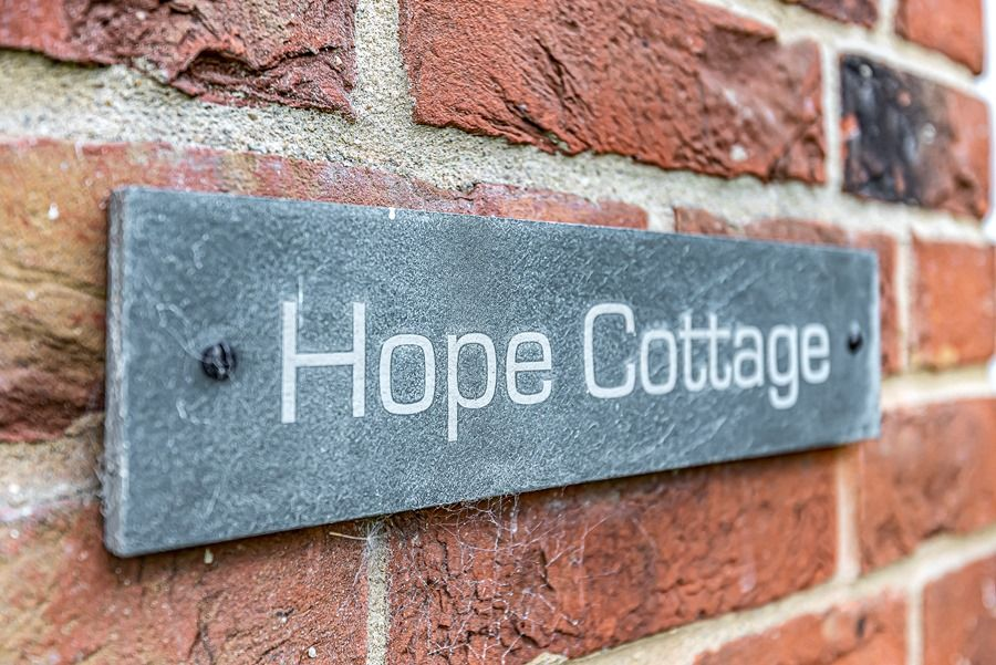 Hope Cottage in Docking | Sign