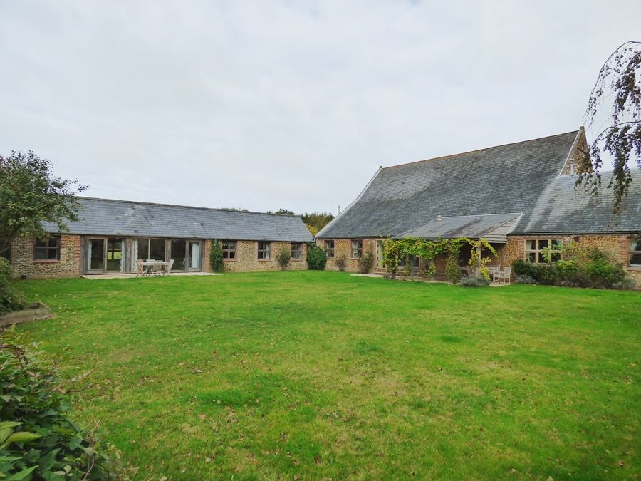 Field Barn House | Shared garden with cottage