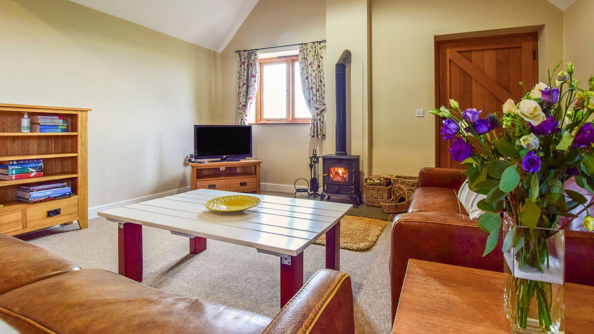 Living room with log burner, Cider House, Bolthole Retreats
