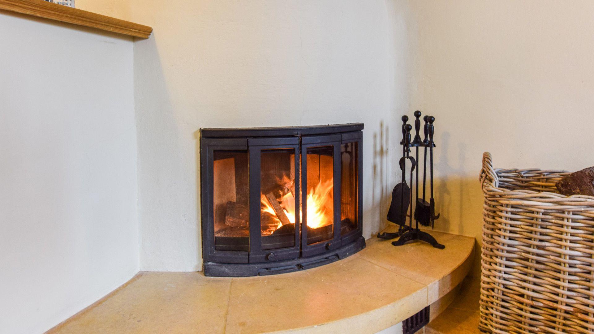 Sitting room fireplace, The Coach House, Bolthole Retreats