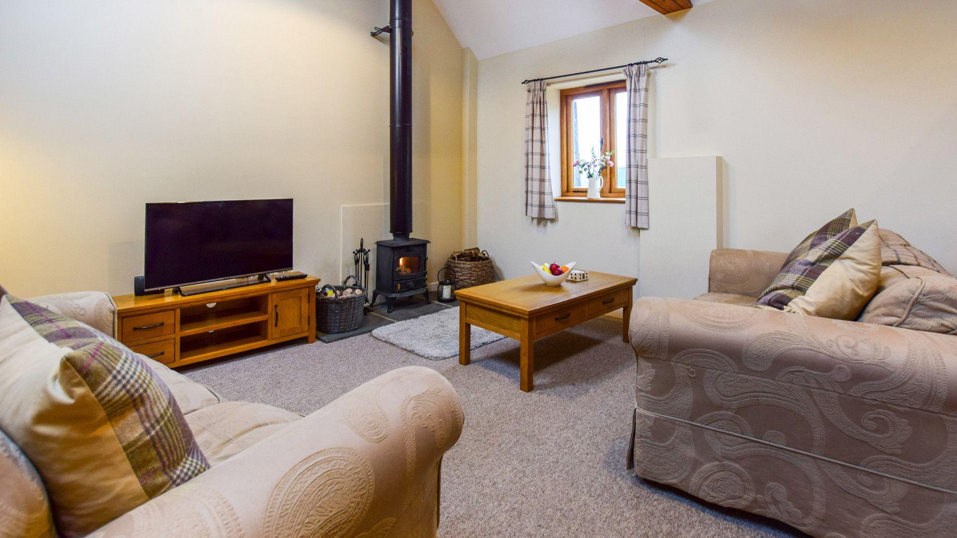 Living area with log burner, Combine Shed, Bolthole Retreats