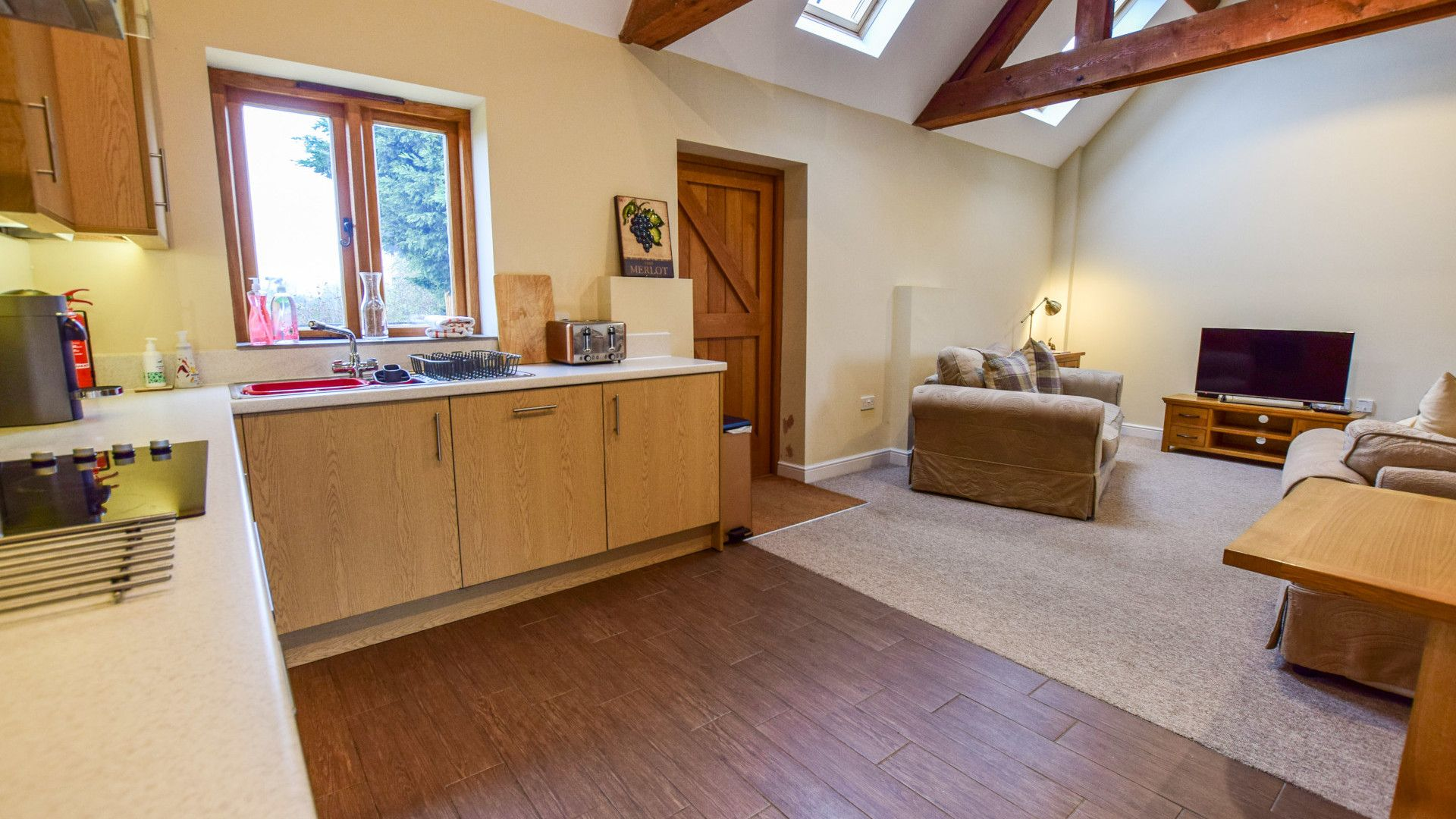 Open plan kitchen, dining area and living room, Combine Shed, Bolthole Retreats