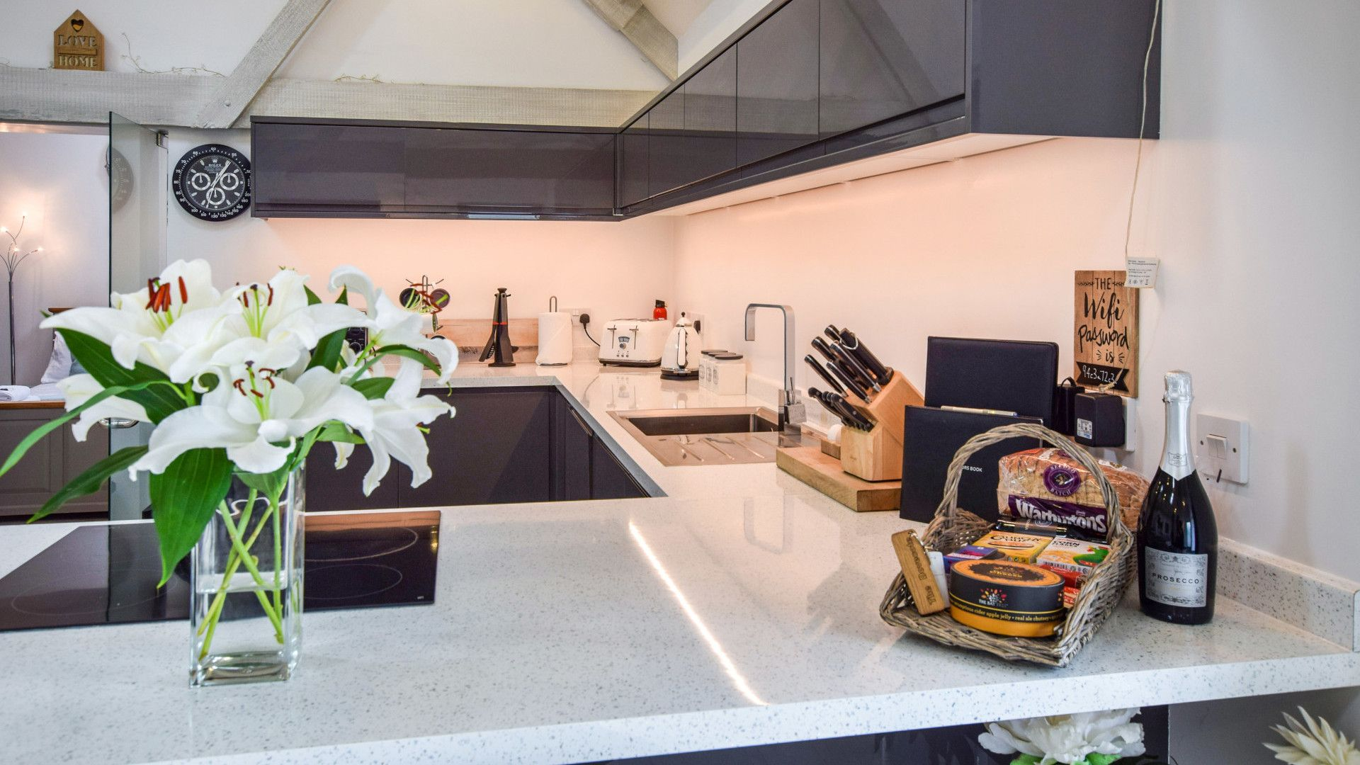 Kitchen with welcome basket, Dovecote at Avon Farm, Bolthole Retreats
