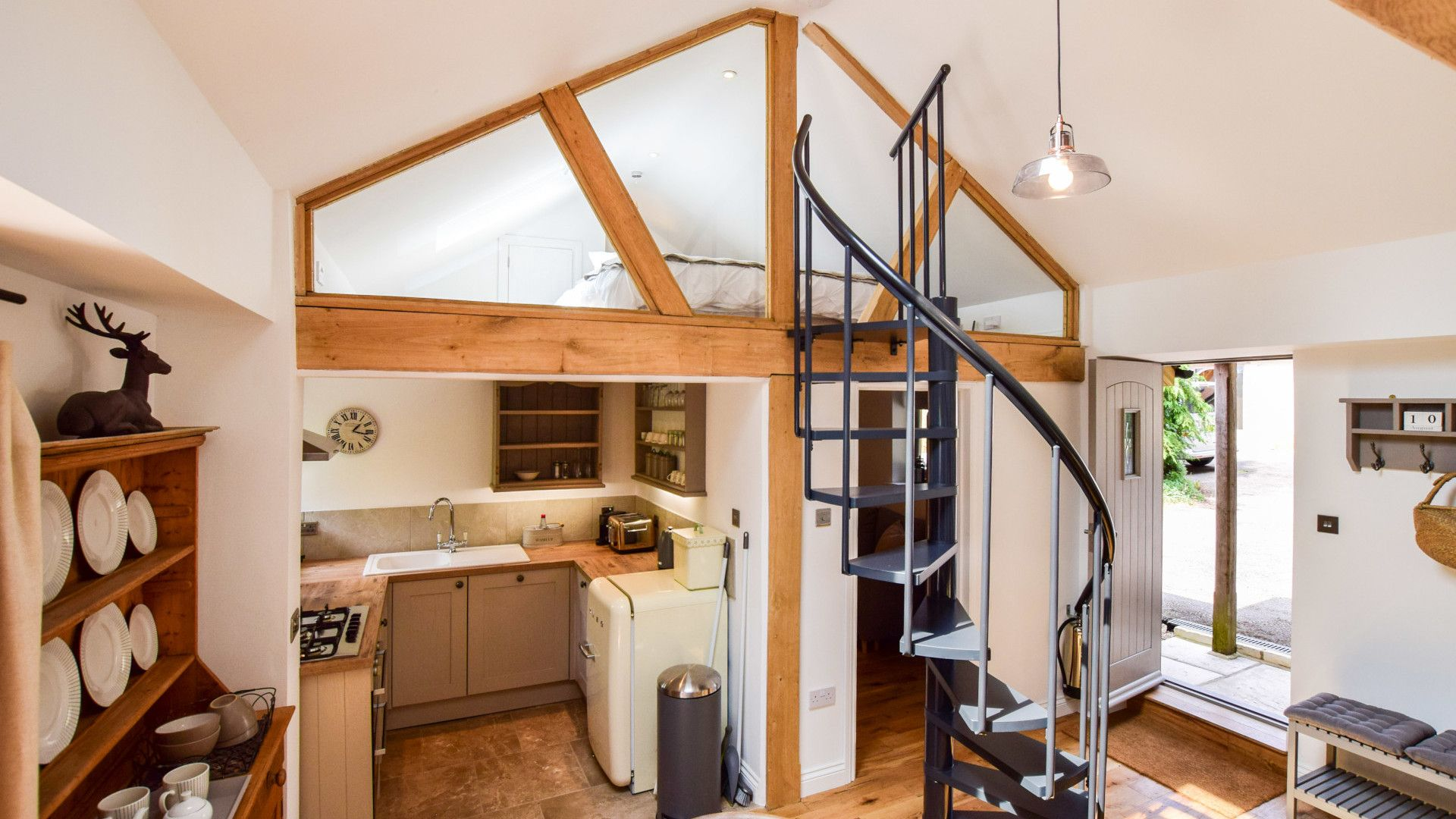 Open plan living area with mezzanine bedroom, Hayloft at Walnut Farm, Bolthole Retreats