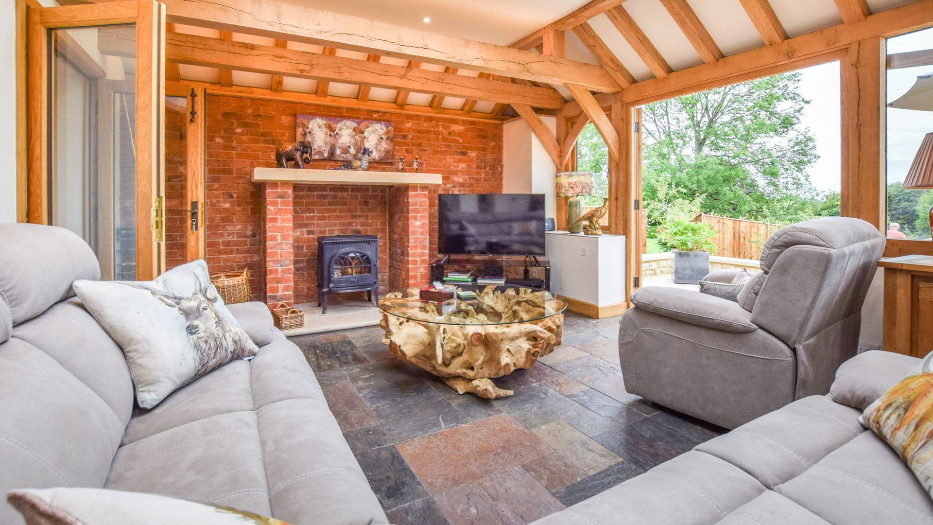 Conservatory living area with log burner, Hyde Tyning Cottage, Bolthole Retreats