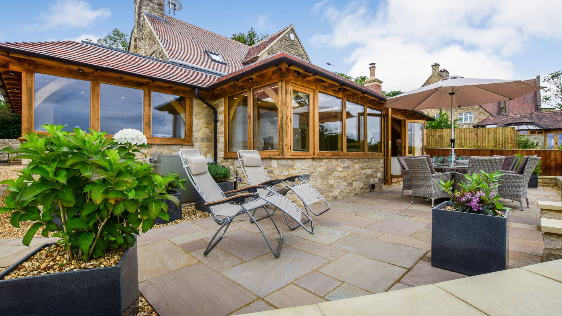 Patio to rear, Hyde Tyning Cottage, Bolthole Retreats