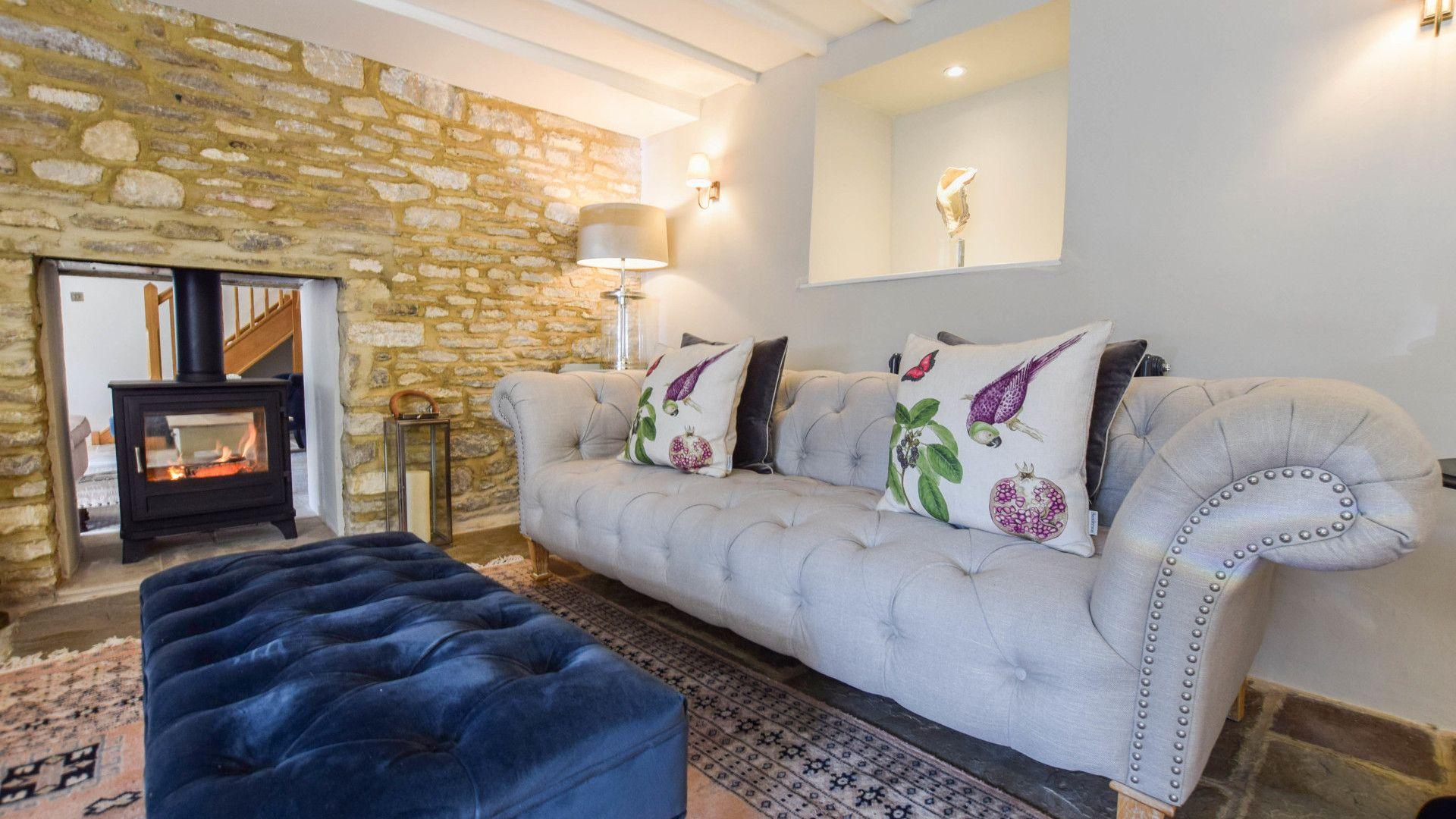 Living room with log burner, Lovell Cottage, Bolthole Retreats