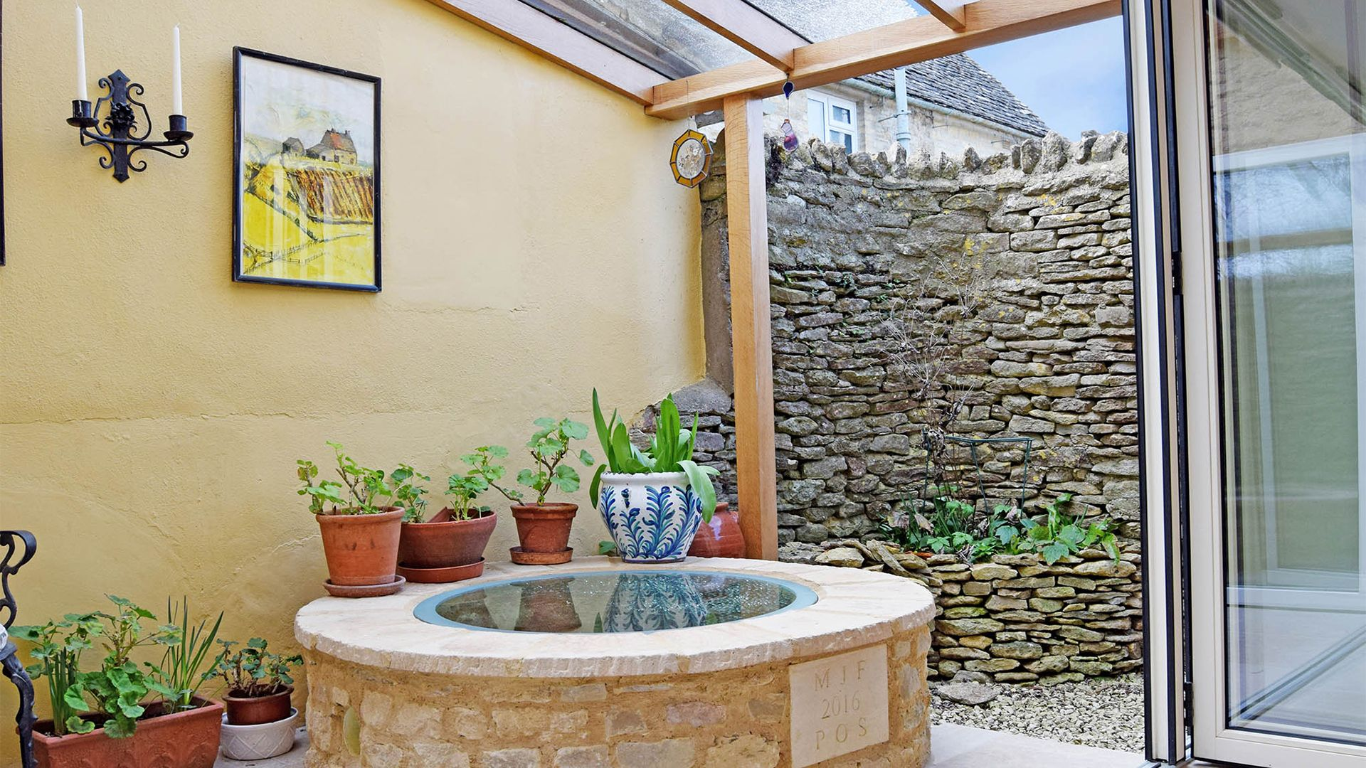 The well in the dining area, Maisey Cottage, Bolthole Retreats