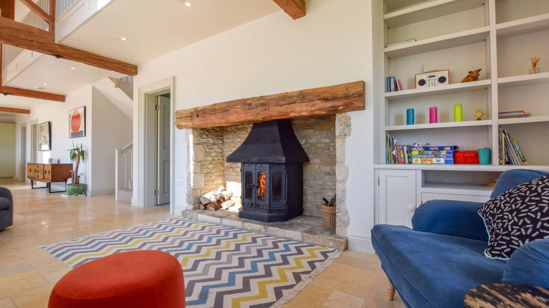 Living area with log burner, Oldbury Barn, Bolthole Retreats