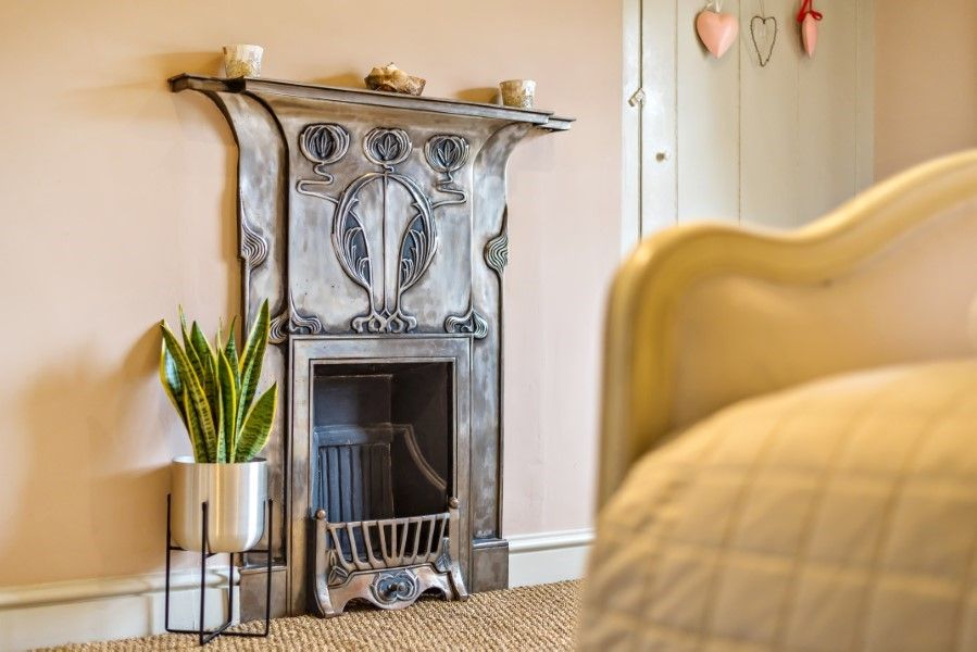 Sutton Cottage | Bedroom fireplace
