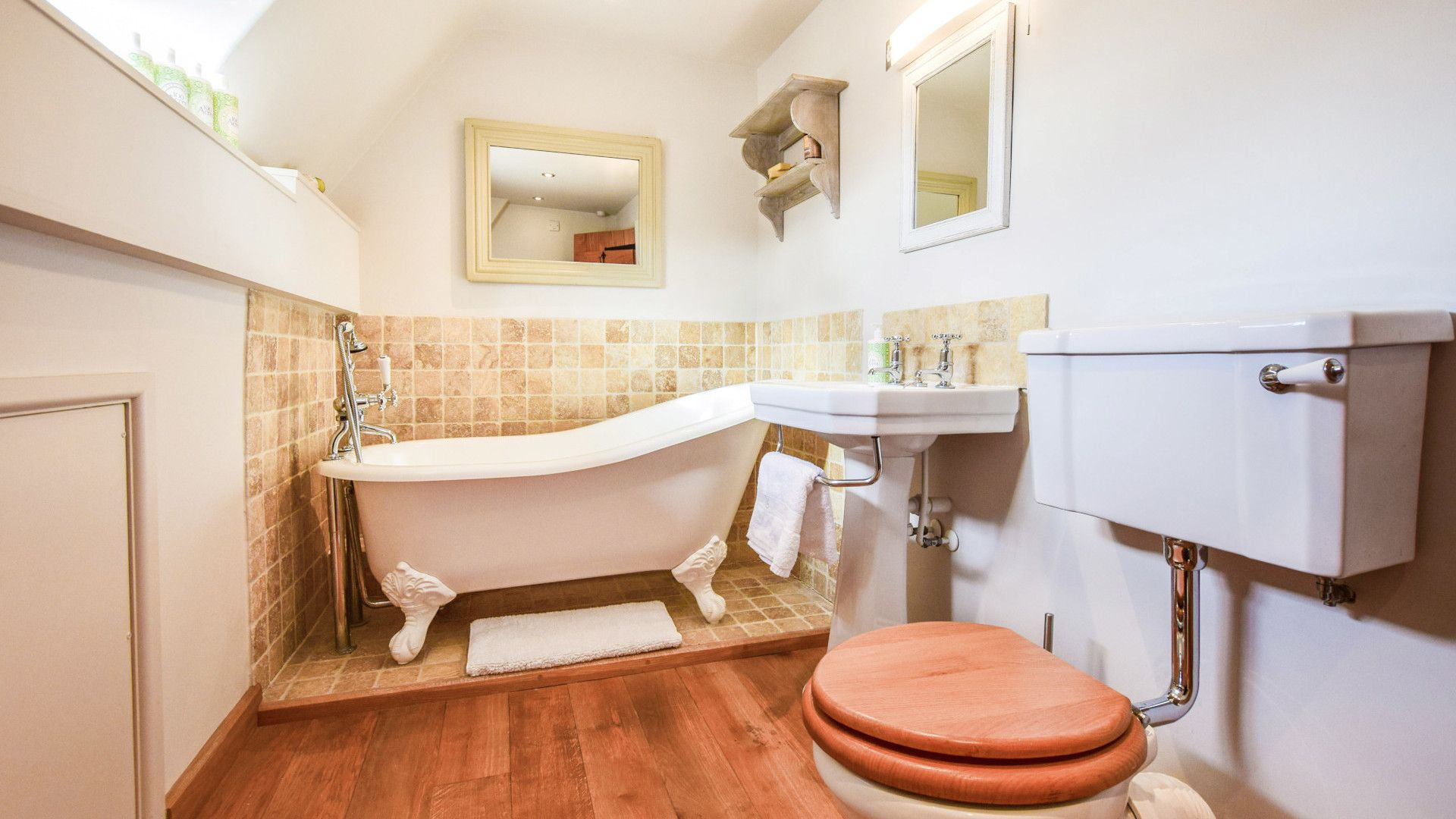 Family bathroom with roll top bath, Bedroom 1 - master with king size bed, Spinners Cottage,  Bolthole Retreats