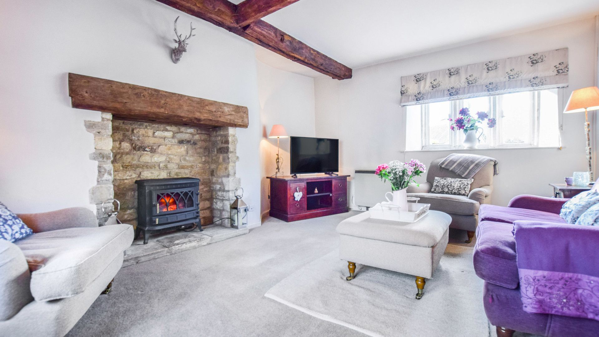 Living room with wood burner effect fireplace, Spinners Cottage,  Bolthole Retreats