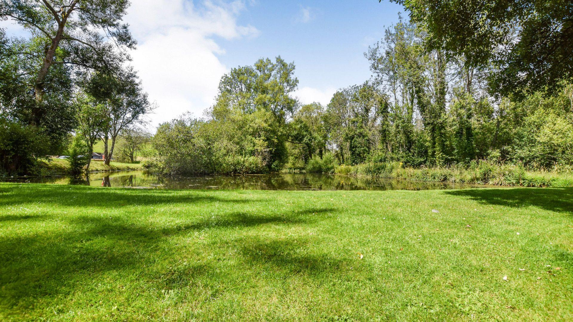 The gardens at the adjacent Inn at Fossebridge, Stable Cottage, Bolthole Retreats