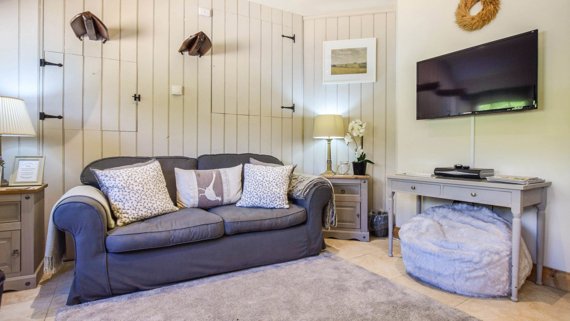 Living area with smart TV, Stable Cottage, Bolthole Retreats
