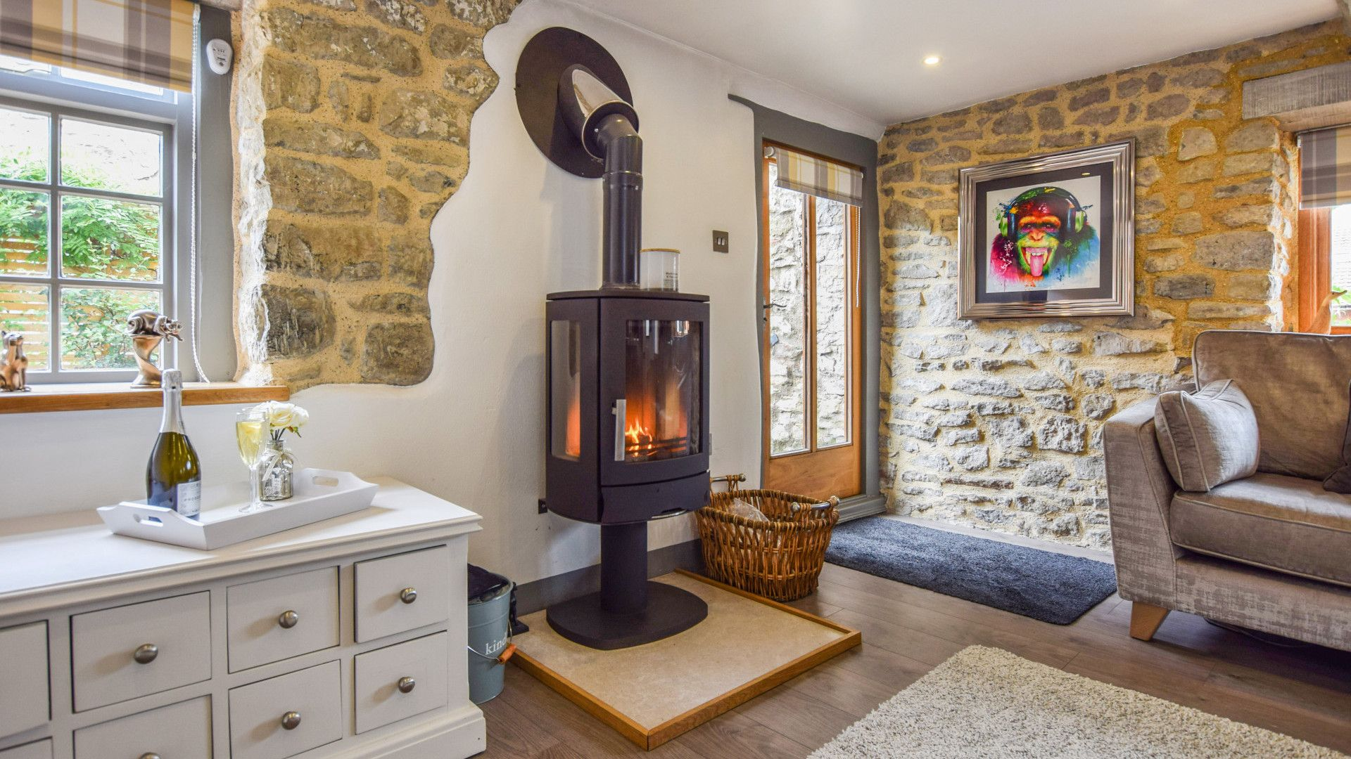 Living area with log burner, Stable Cottage at Avon Farm, Bolthole Retreats
