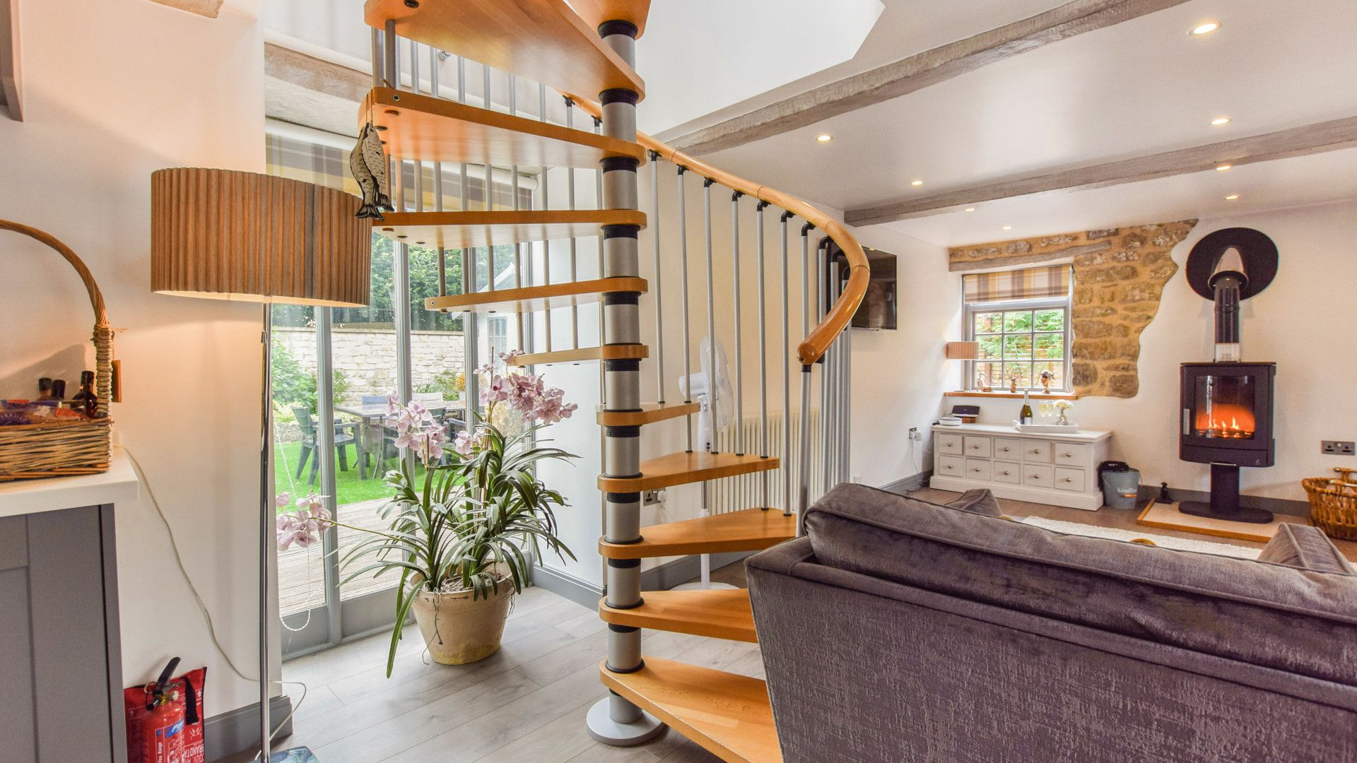 Living area with spiral staircase, Stable Cottage at Avon Farm, Bolthole Retreats