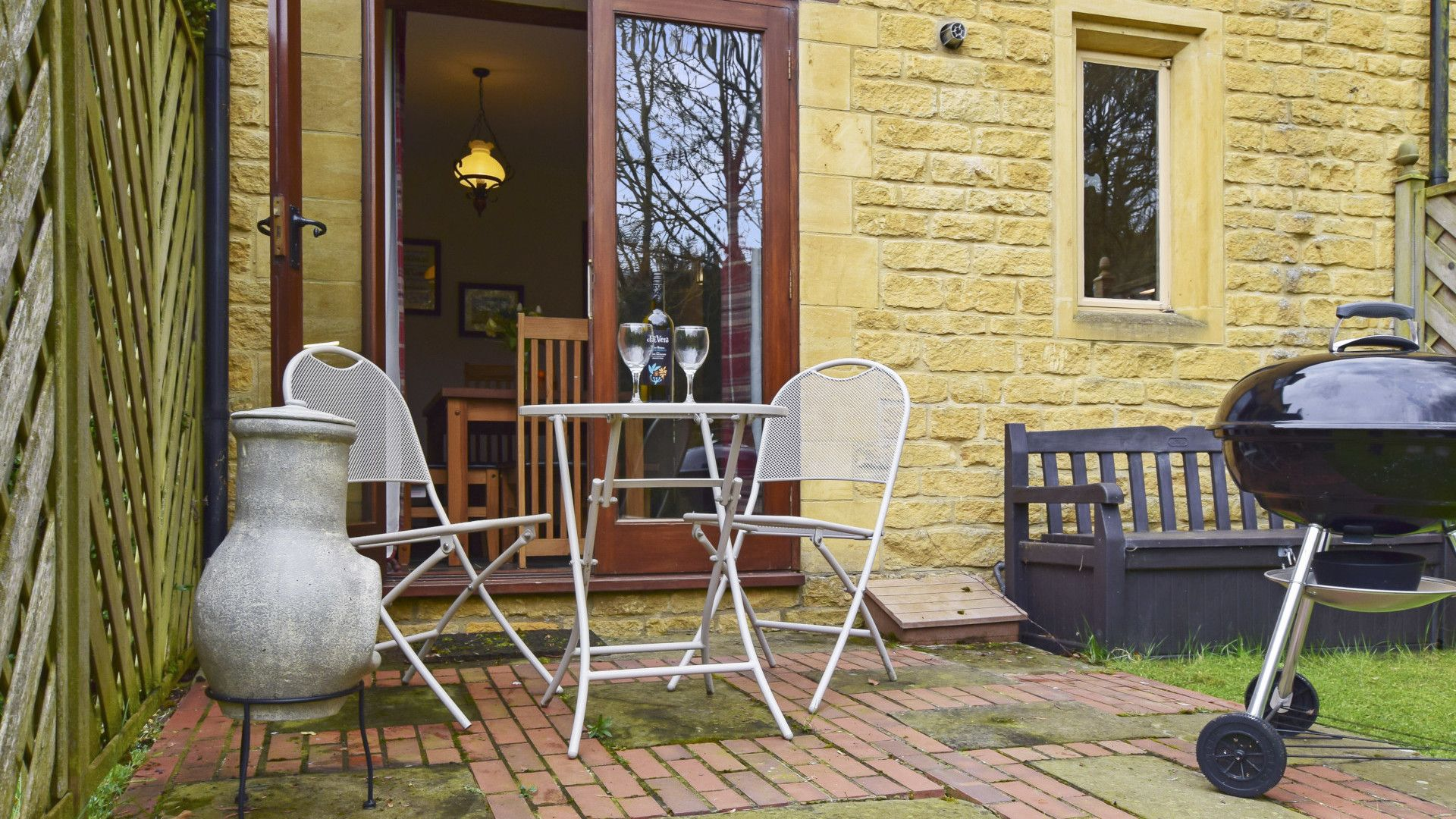 Patio area with BBQ and seating, Stepping Stones, Bolthole Retreats