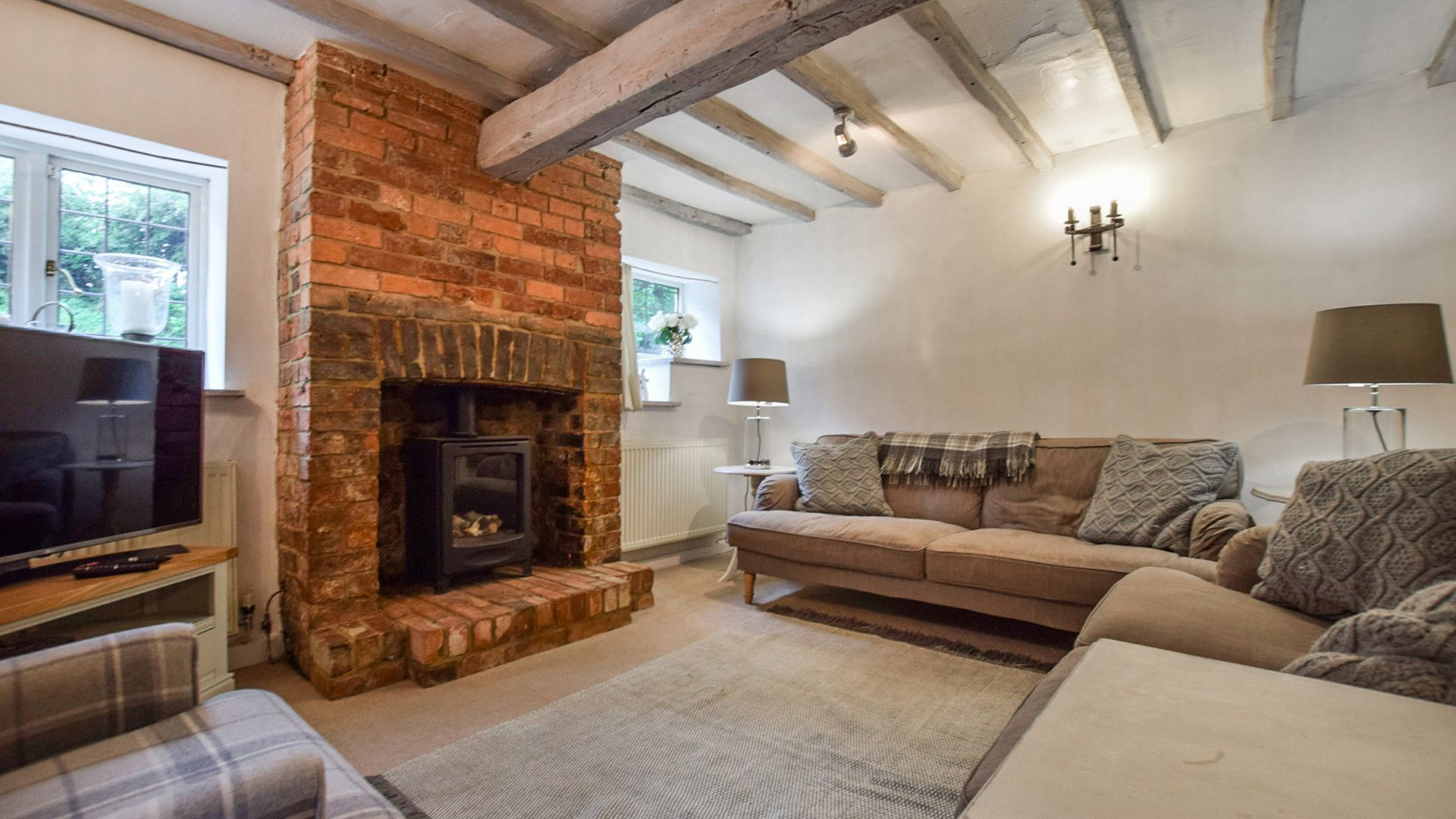 Living room with gas fireplace,  Suncroft, Bolthole Retreats