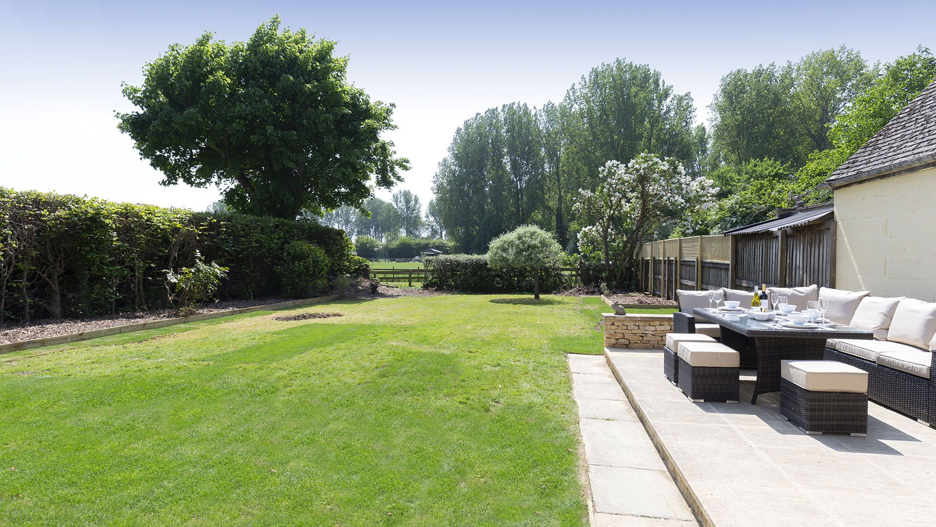 Rear garden with patio and seating,  South Winds, Bolthole Retreats