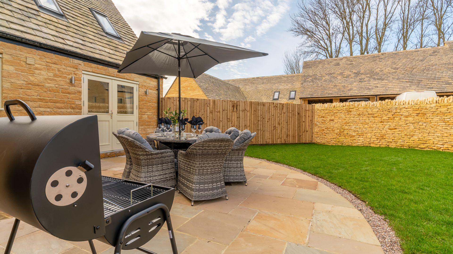 Patio with seating & BBQ, Rowan House, Bolthole Retreats