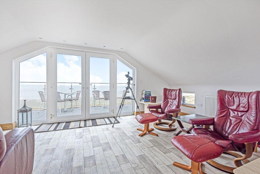 Foam Crest | Sitting room leading to balcony