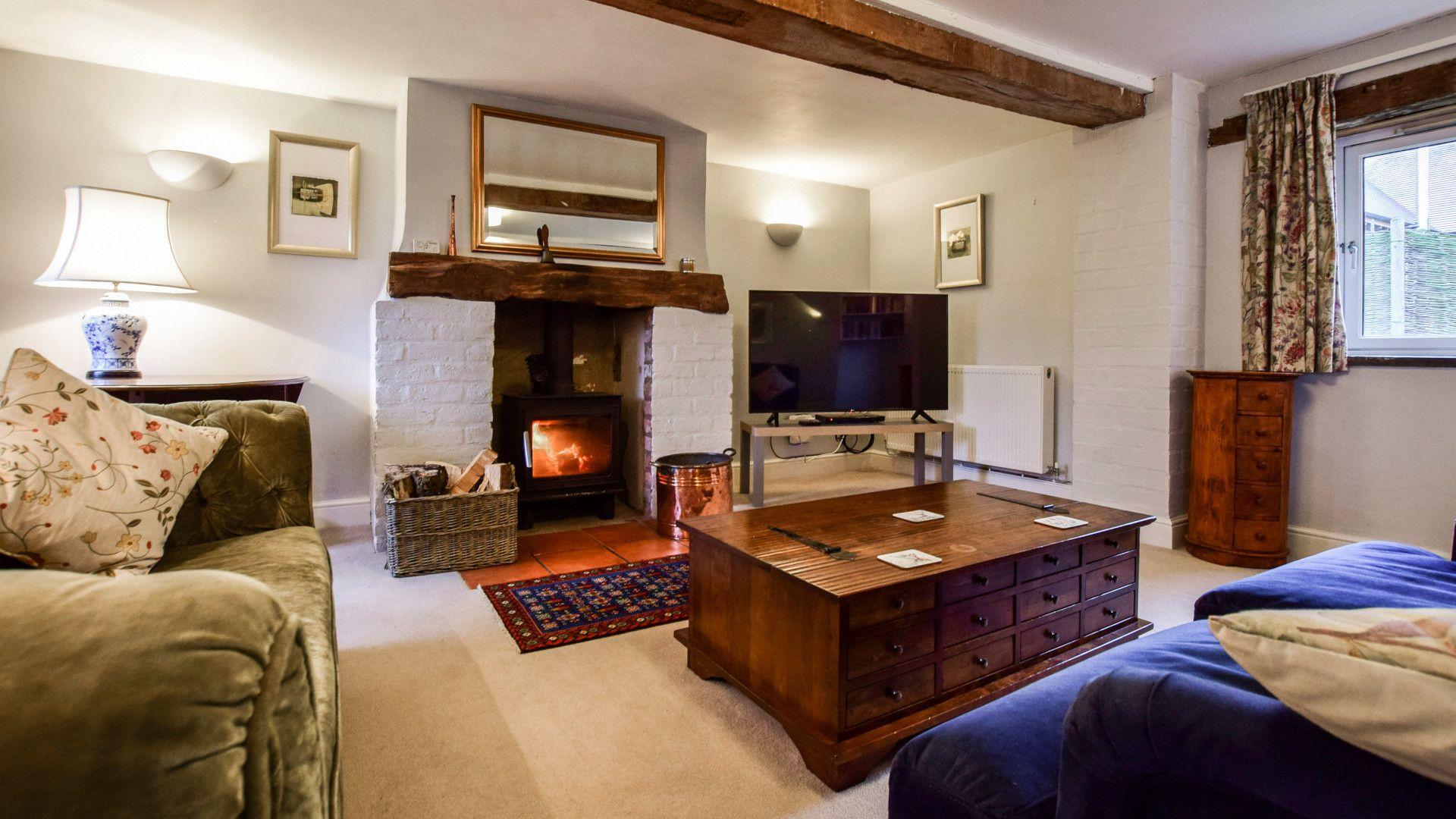 Living room with log burner, Granary at Hunt Court, Bolthole Retreats