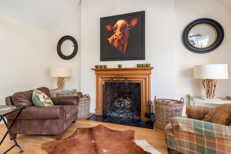 Yew Tree House | Fireplace in dining area