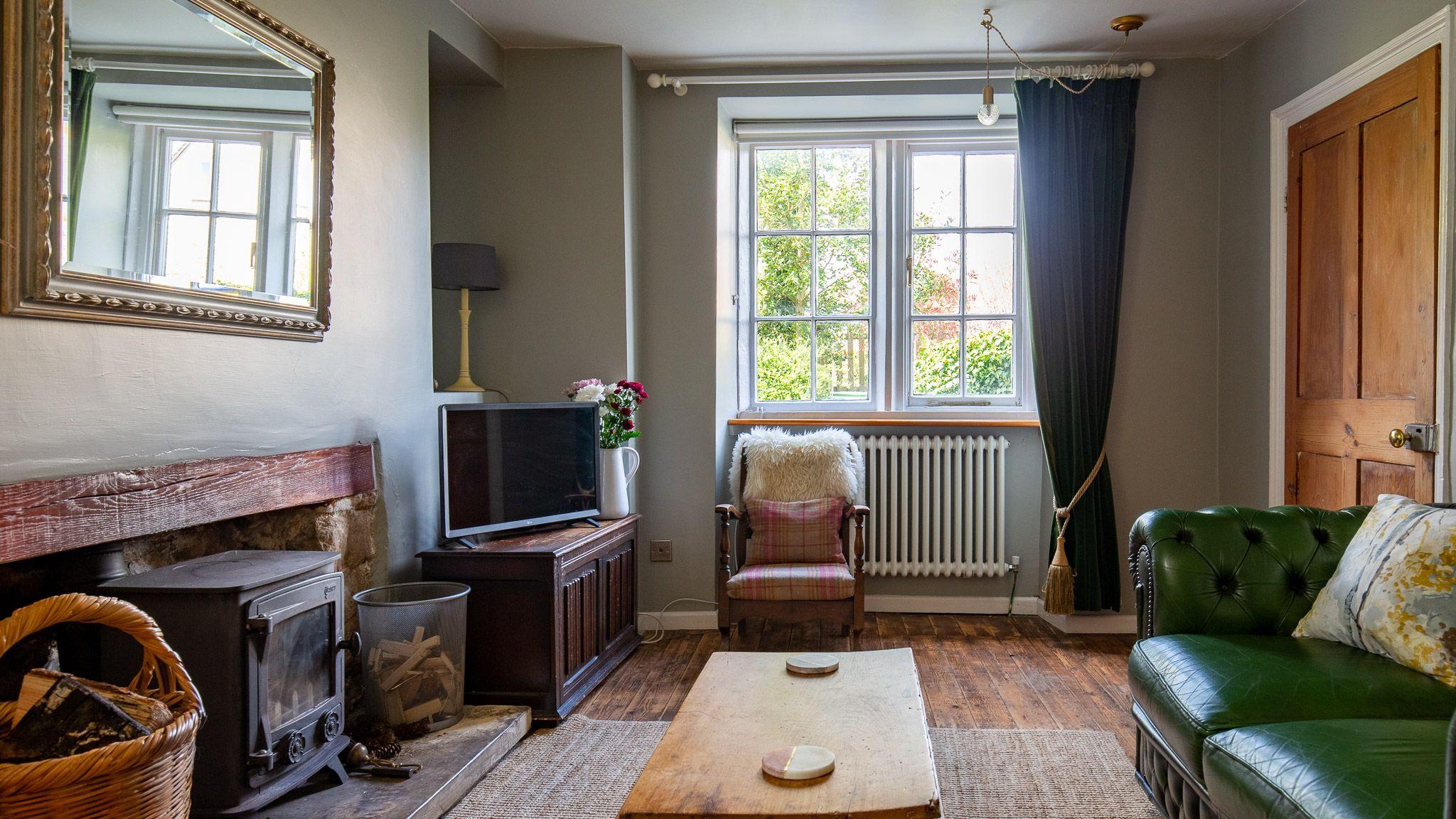 Living room with log burner, Walkley Wood Cottage, Bolthole Retreats