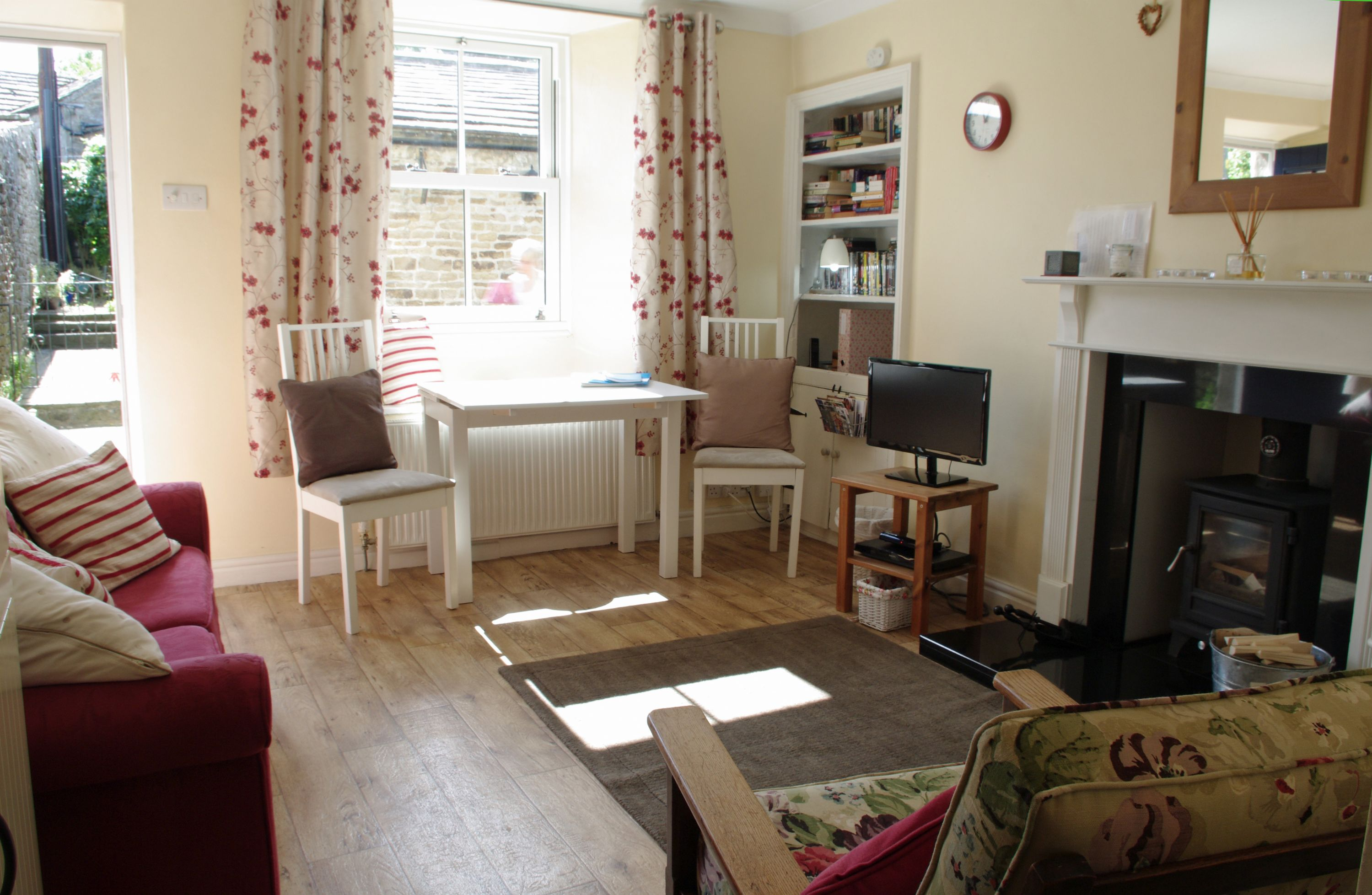 Lounge with cosy woodburning stove at Lion Cottage in Bainbridge, Wensleydale in the Yorkshire Dales