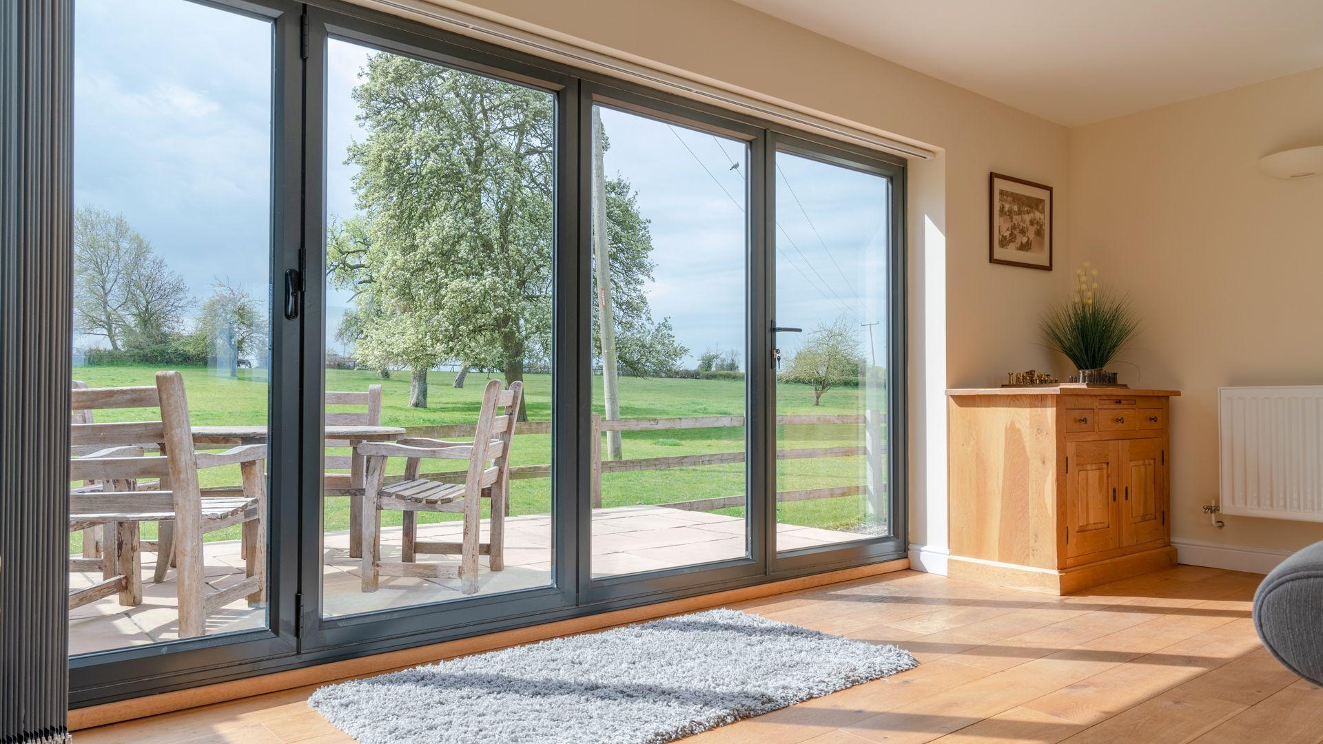 Living Room closed bi-fold doors, Orchard View, Bolthole Retreats