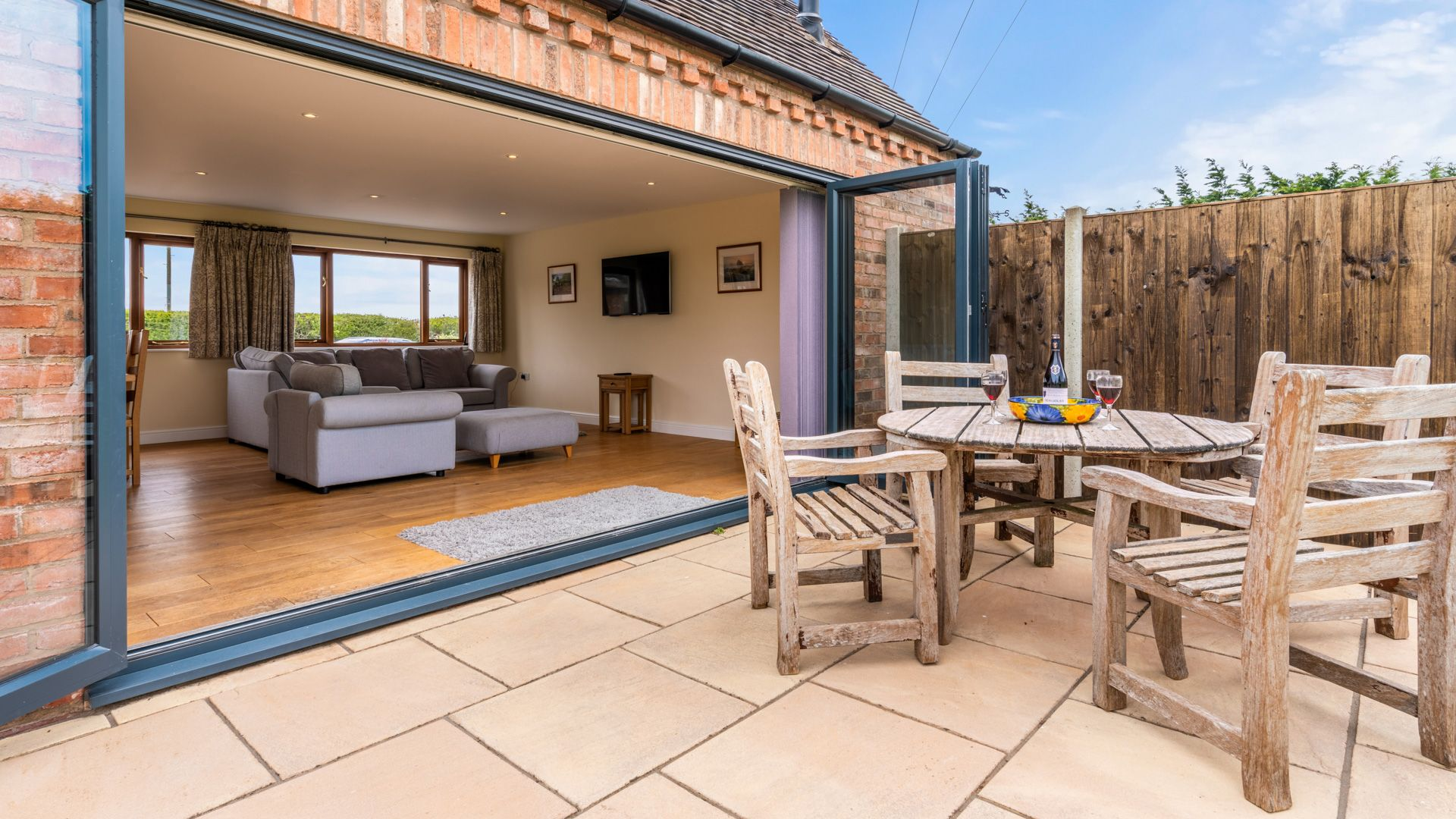 Rear patio and living room, Orchard View, Bolthole Retreats