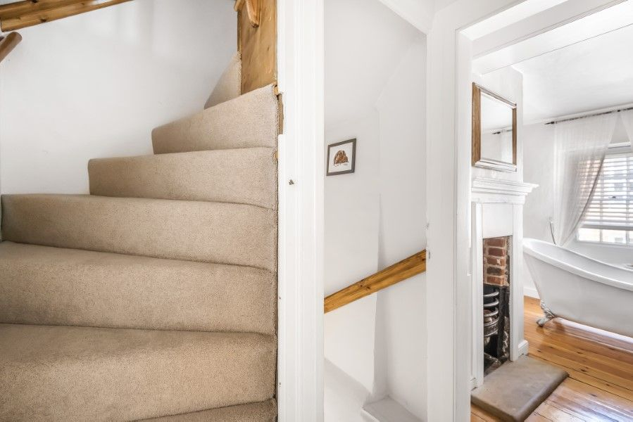 Skeet Cottage | Staircase up to top floor