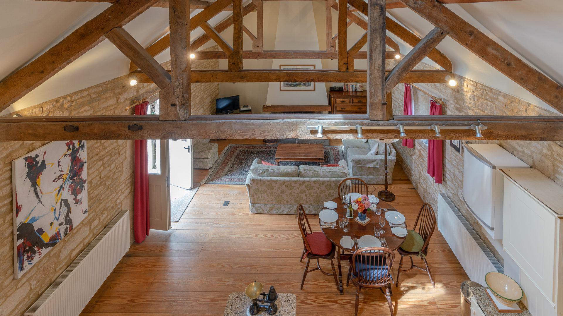 Looking down from mezzanine study, Aylworth Manor Granary, Bolthole Retreats