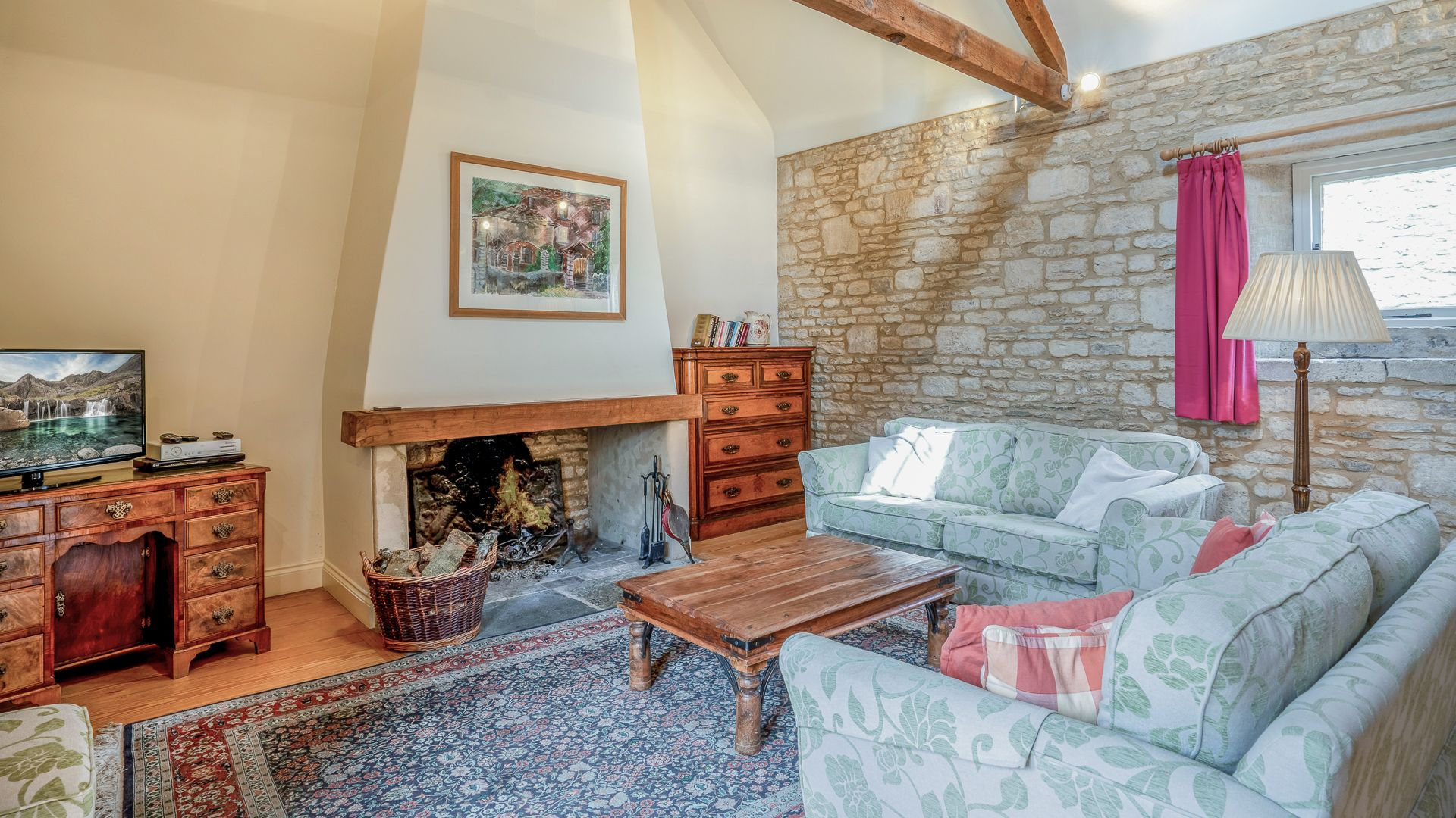 Living area and open fire, Aylworth Manor Granary, Bolthole Retreats