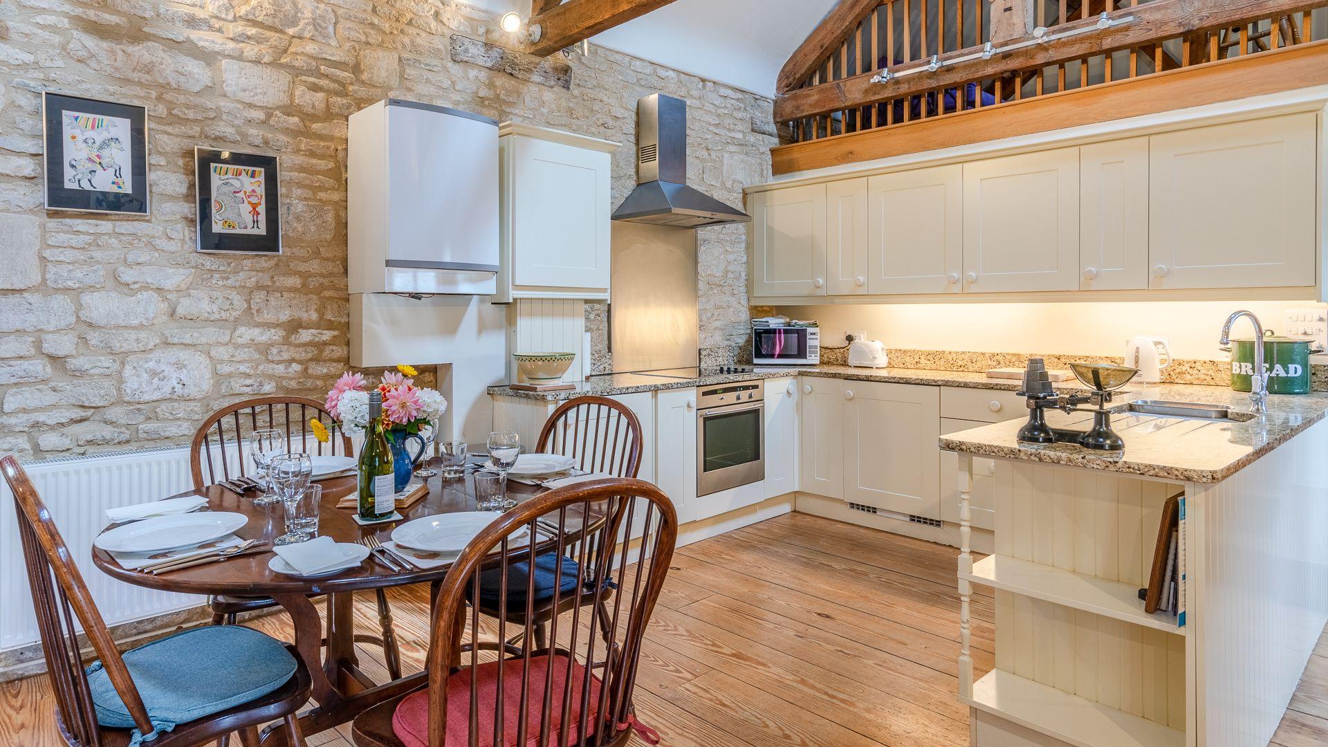 Dining-kitchen area, Aylworth Manor Granary, Bolthole Retreats