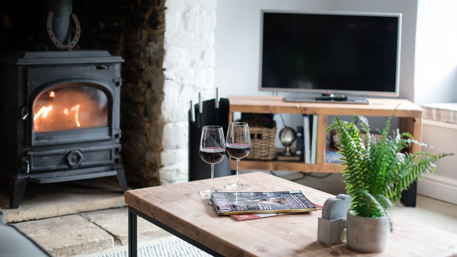 Living room with woodburner and TV, Hillside Cottage, Bolthole Retreats