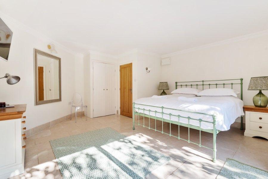 Aster House | Bedroom 1 with patio doors