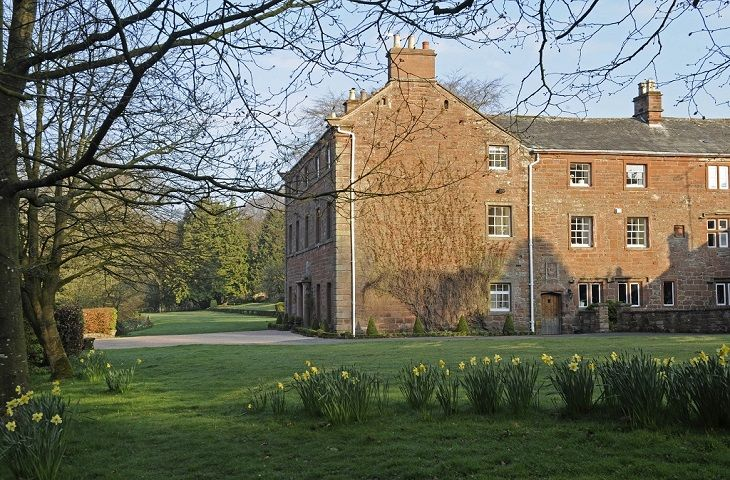 The grounds include an archery lawn, walled vegetable gardens and a Victorian castle folly at the foot of the lawn (now converted to a children's play area). The forested grounds of 20 acres incorporate a small tributary of the River Eden with picnic area