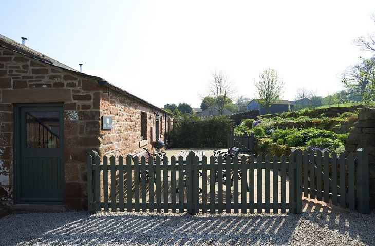 Gated enclosed sandstone terrace to the rear benefits from lovely raised flower beds leading up to a lawned area (not enclosed)