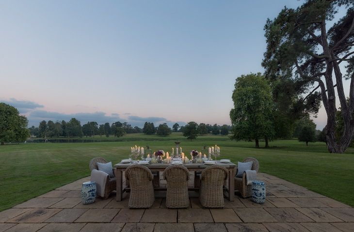 The patio area outside the front of the property, with table and chairs to take in the stunning views across the parkland