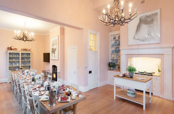Ground floor: Family kitchen with seating for ten, an Aga and butler sinks