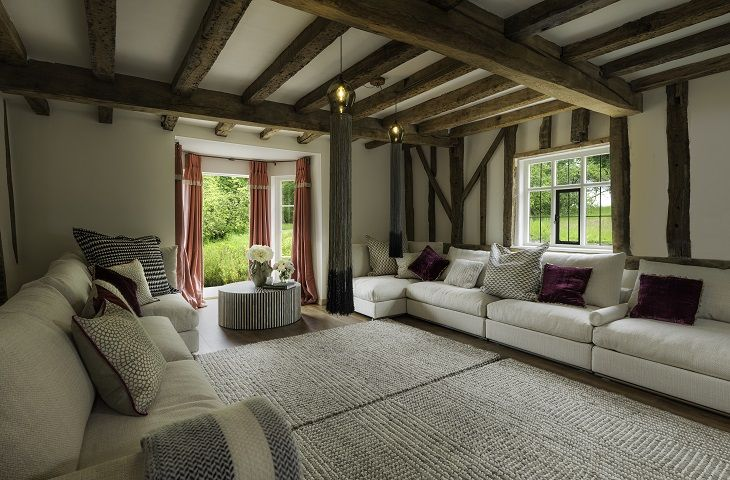 Ground floor:  Drawing room with exposed beams and ample seating