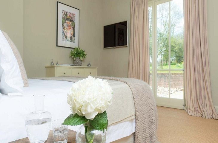 The Clockhouse:  Double bedroom with French window to patio