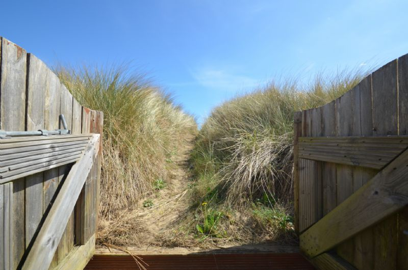 Access to beach path through garden gate